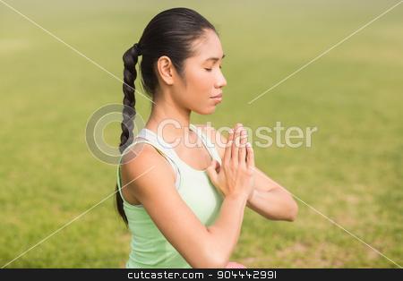 Peaceful sporty woman doing yoga stock photo, Peaceful sporty woman doing yoga in parkland by Wavebreak Media
