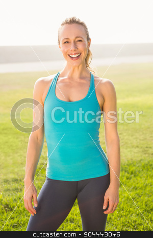 Smiling fit blonde looking at camera stock photo, Portrait of smiling fit blonde looking at camera in parkland by Wavebreak Media