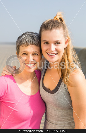 Sporty mother and daughter smiling stock photo, Portrait of sporty mother and daughter smiling at promenade by Wavebreak Media