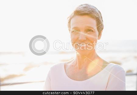 Smiling sporty woman at promenade stock photo, Portrait of smiling sporty woman at promenade on a sunny day by Wavebreak Media