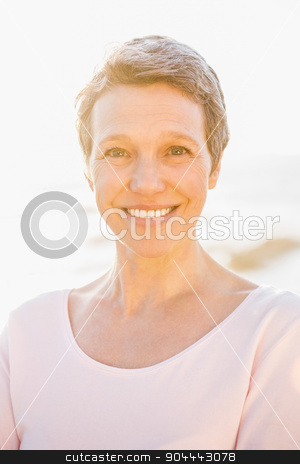 Smiling sporty woman at promenade stock photo, Portrait of smiling sporty woman at promenade on a sunny day by Wavebreak Media