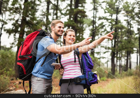 Young happy hikers pointing int he distance stock photo, Young happy hikers pointing int he distance in the nature by Wavebreak Media