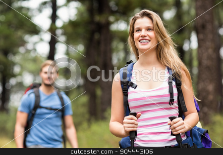 Pretty young hiker with friend stock photo, Pretty young hiker with friend in the nature by Wavebreak Media