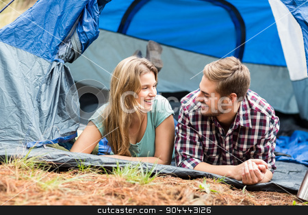 Young pretty hiker couple lying in a tent stock photo, Young pretty hiker couple lying in a tent in the nature by Wavebreak Media