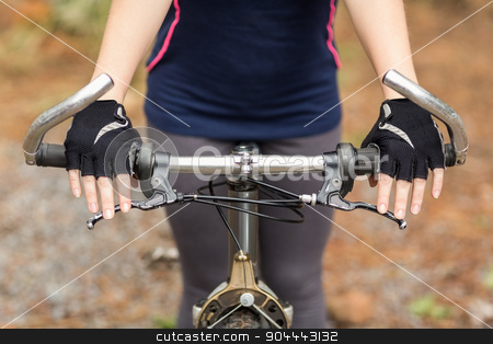 Close up view of hands on handlebar stock photo, Close up view of hands on handlebar in the nature by Wavebreak Media