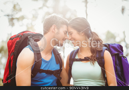 Young happy joggers touching foreheads stock photo, Young happy joggers touching foreheads in the nature by Wavebreak Media