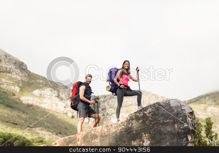 Young happy joggers standing on rock stock photo, Young happy joggers standing on rock in the nature by Wavebreak Media