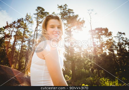 Young happy jogger looking at camera stock photo, Young happy jogger looking at camera in the nature by Wavebreak Media