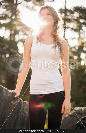 Young happy jogger looking at something in the distance stock photo, Young happy jogger looking at something in the distance in the nature by Wavebreak Media