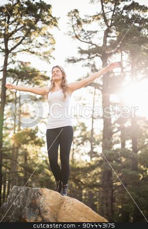 Young happy jogger feeling free stock photo, Young happy jogger feeling free in the nature by Wavebreak Media