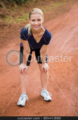Smiling athletic blonde resting stock photo, Portrait of smiling athletic blonde resting in the nature by Wavebreak Media