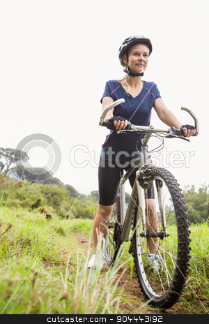 Athletic blonde sitting on mountain bike stock photo, Athletic blonde sitting on mountain bike in the nature by Wavebreak Media