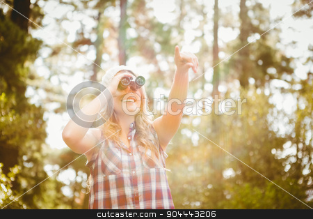 Pretty young blonde looking through binoculars  stock photo, Pretty young blonde looking through binoculars in the nature by Wavebreak Media