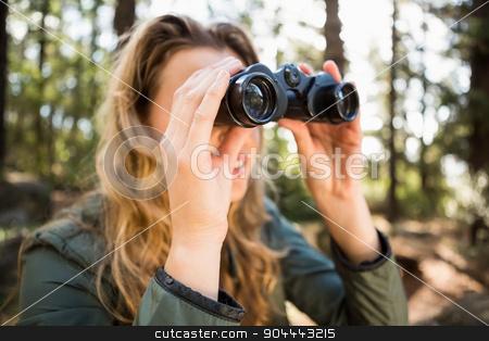 Blonde hiker looking through binoculars stock photo, Blonde hiker looking through binoculars in the nature by Wavebreak Media