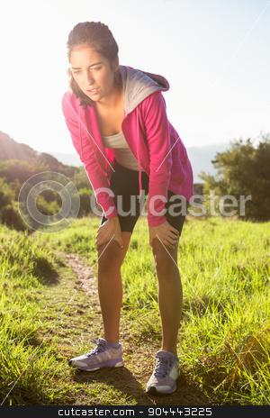 Breathing athletic brunette resting stock photo, Breathing athletic brunette resting in the nature by Wavebreak Media
