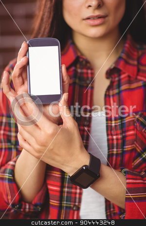 Pretty hipster showing her smartphone stock photo, Pretty hipster showing her smartphone on red brick background by Wavebreak Media