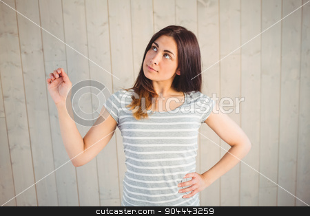 Pretty hipster with hand up stock photo, Pretty hipster with hand up on wooden planks background by Wavebreak Media