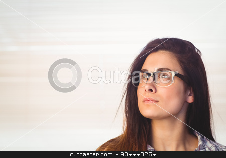 Pretty hipster looking up  stock photo, Pretty hipster looking up in a bright room by Wavebreak Media