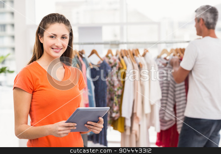 Smiling casual businesswoman volunteering stock photo, Portrait of smiling casual businesswoman volunteering in the office by Wavebreak Media