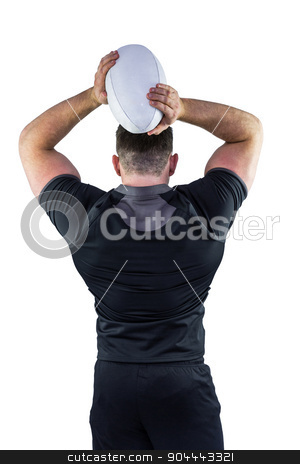 Tough rugby player throwing ball stock photo, Tough rugby player throwing ball on white background by Wavebreak Media