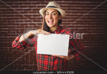 Beautiful hipster showing white card stock photo, Beautiful hipster showing white card on red brick background by Wavebreak Media