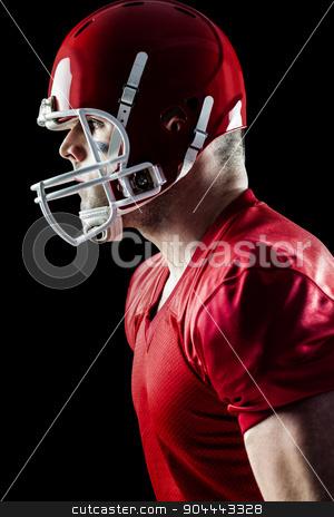American football player side profile stock photo, American football player side profile on black background by Wavebreak Media