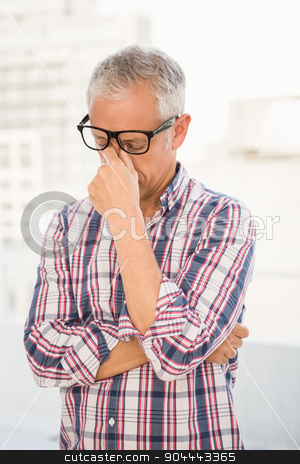 Troubled casual businessman  stock photo, Troubled casual businessman in the office by Wavebreak Media