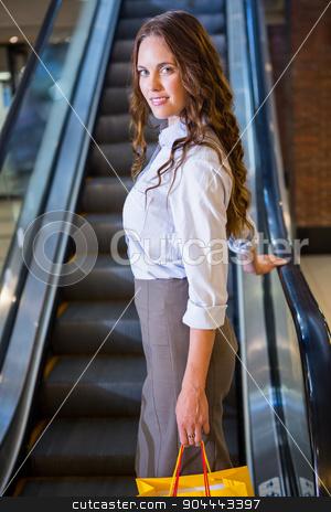 Pretty woman by the escalator stock photo, Pretty woman by the escalator at the shopping mall by Wavebreak Media