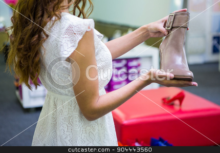 Pretty woman shopping for shoes stock photo, Pretty woman shopping for shoes at the shopping mall by Wavebreak Media