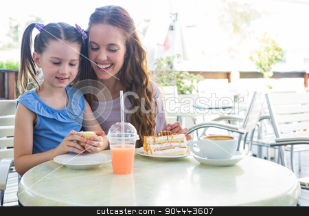 Mother and daughter at cafe terrace stock photo, Mother and daughter at cafe terrace on a sunny day by Wavebreak Media