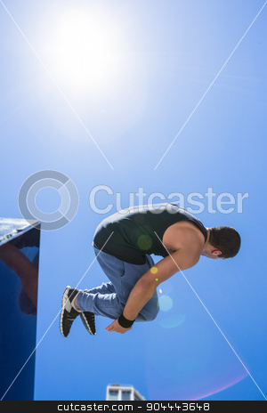 Man doing free-running in the city stock photo, Man doing free-running in the city on a sunny day by Wavebreak Media