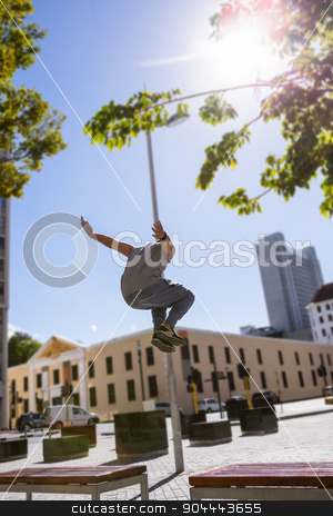 Man doing parkour in the city stock photo, Man doing parkour in the city on a sunny day by Wavebreak Media