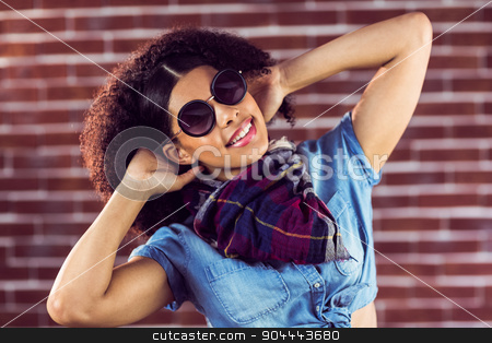 Attractive young woman feeling good stock photo, Portrait of attractive young woman feeling good against red brick background by Wavebreak Media