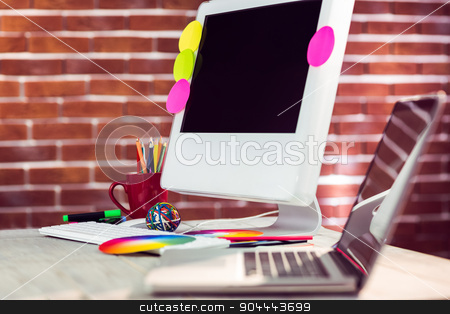 Close up view of creative workplace  stock photo, Close up view of creative workplace against red brick background by Wavebreak Media