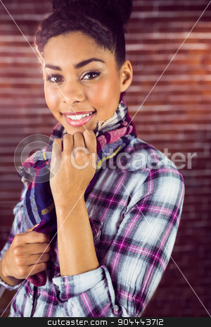 Portrait of a beautiful smiling hipster stock photo, Portrait of a beautiful smiling hipster against a red brick wall by Wavebreak Media