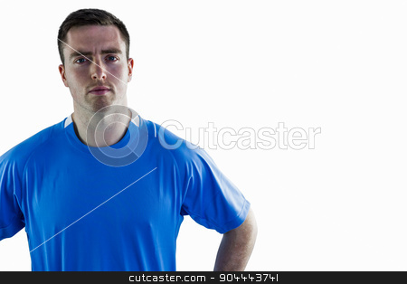 Rugby player with hands on hips stock photo, Portrait of a serious rugby player with hands on hips by Wavebreak Media
