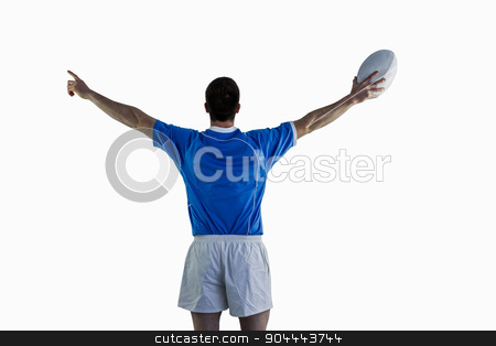 Rugby player gesturing with hands stock photo, Rugby player gesturing with hands and holding a rugby ball by Wavebreak Media