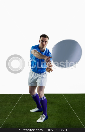 Rugby player about to throw a rugby ball stock photo, Rugbyman about to throw a rugby ball on a white background by Wavebreak Media