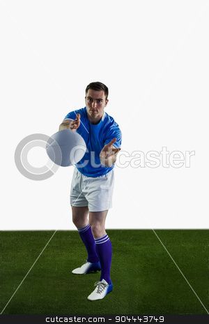 Rugby player throwing a rugby ball stock photo, Portrait of a rugby player throwing a rugby ball by Wavebreak Media