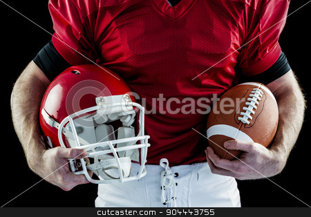 American football player holding helmet stock photo, American football player holding helmet and american football by Wavebreak Media