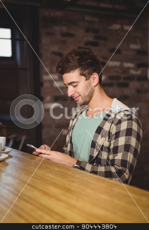 Smiling hipster sitting and texting stock photo, Smiling hipster sitting and texting at coffee shop by Wavebreak Media