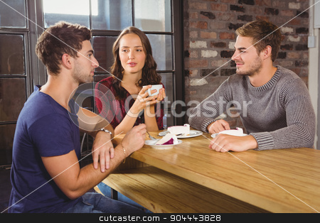 Friends talking and enjoying coffee and cake stock photo, Friends talking and enjoying coffee and cake at coffee shop by Wavebreak Media