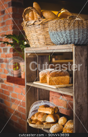 Breads on a shelf stock photo, Breads on a shelf at coffee shop by Wavebreak Media