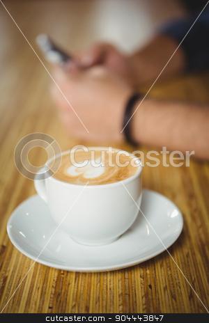 High angle close-up of coffee stock photo,  High angle close-up of coffee over wooden background by Wavebreak Media