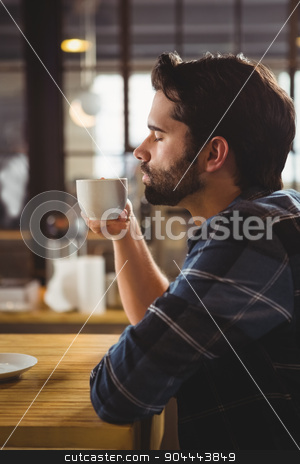 Worried man drinking a coffee stock photo, Worried man drinking a coffee at the cafe by Wavebreak Media