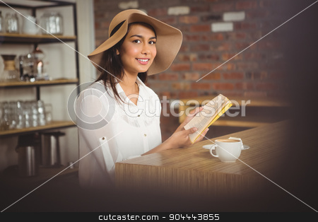 Beautiful businesswoman reading a book stock photo, Beautiful businesswoman reading a book outside at the coffee shop by Wavebreak Media