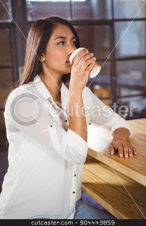 Beautiful woman drinking a coffee stock photo, Beautiful woman drinking a coffee in cafe by Wavebreak Media