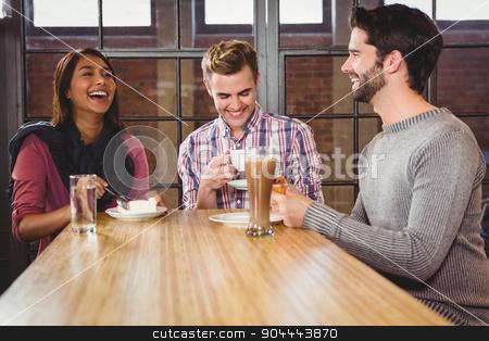 Group of friends enjoying a dessert  stock photo, Group of friends enjoying a dessert in a cafe by Wavebreak Media