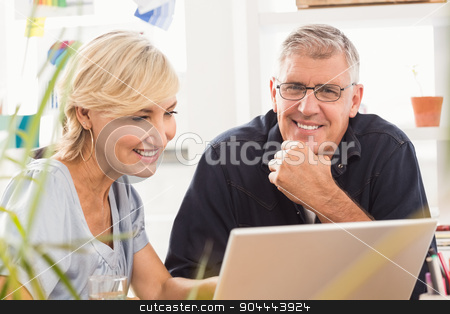 Smiling business team working on laptop stock photo, Portrait of smiling business team working on laptop at office by Wavebreak Media