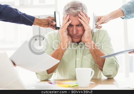 Overwrought businessman with hands on head stock photo, Overwrought businessman with hands on head at the office by Wavebreak Media